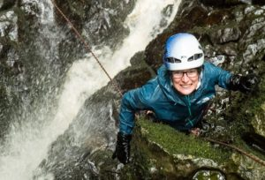 Picture of Communications Officer Abi enjoying a ghyll scramble in the Yorkshire Dales