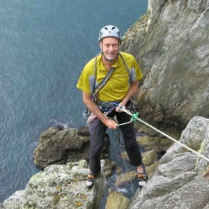 Picture of Membership Secretary Jules abseiling into 'Dream of White Horses' at Gogarth