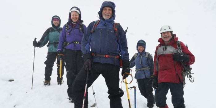 Mynydd members victorious at top of Number four gully in white-out conditions on Ben Nevis
