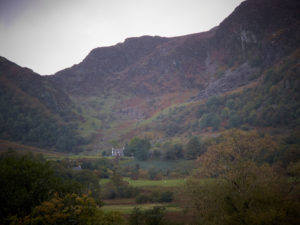 Picture of club hut Blaen-y-Nant taken from Llyn Craftnant with the crags rising above it.